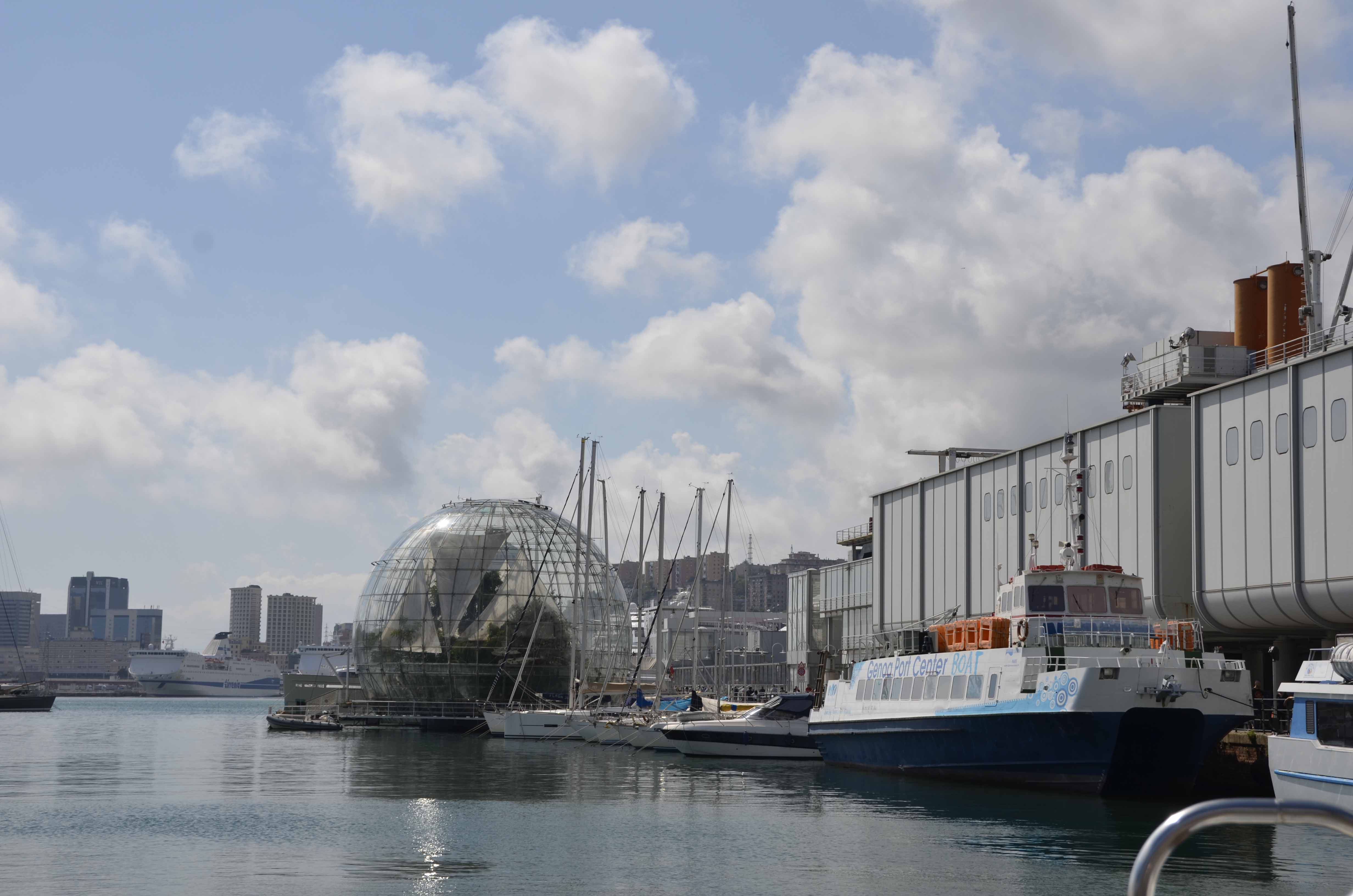 A modern first class aquarium beckons amidst the busy commercial port.
